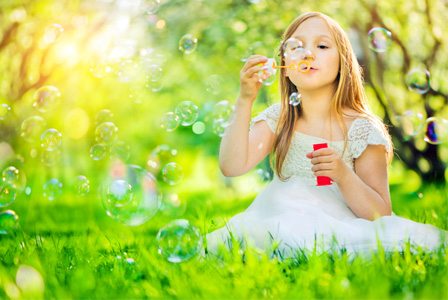 little-girl-blowing-bubbles